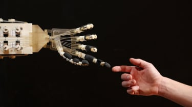 A robotic hand interacts with a person