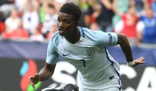 Demarai Gray celebrates after scoring for England U-21