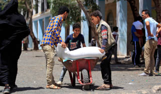 Yemenis receive humanitarian aid