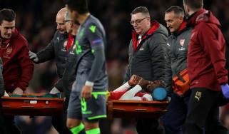 Arsenal striker Danny Welbeck was stretchered off against Sporting Lisbon