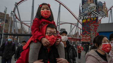 A father and daughter celebrating Chinese New Year