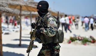 Armed guards patrol Marhaba beach, Tunisia