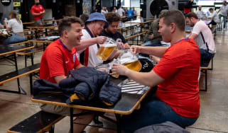England fans pour pitchers of beer at Boxpark Wembley on Wednesday
