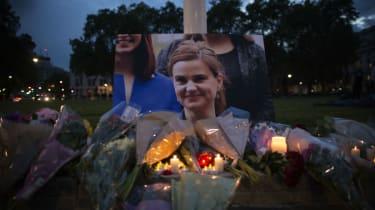 Flowers surround a picture of pro-EU politician Jo Cox during a vigil in Parliament Square