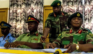 Zimbabwe's army, led by Gen Constantino Chiwenga (right) has vowed to 'step in' to stop purges within Zanu-PF