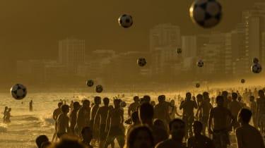 Footballing beach-goers in Rio