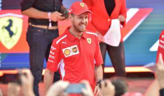 Ferrari driver Sebastian Vettel greets F1 fans at the season launch event in Melbourne