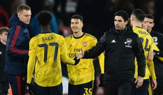 Arsenal head coach Mikel Arteta congratulates his players after the FA Cup win at Bournemouth