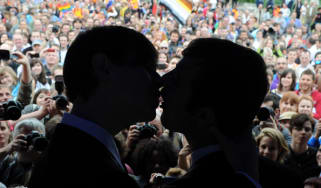 Two men kiss during the Rainbow Pride Parade, a march for the human rights of non-heterosexual people and the celebration of LGBT (lesbian, gay, bisexual, transgender) pride, in Bratislava on
