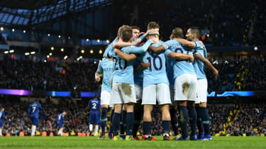 Manchester City players congratulate Sergio Aguero after he scored the team's fifth against Chelsea