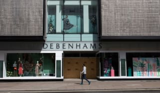 A man walks past a closed Debenhams on Oxford Street, London during the UK coronavirus lockdown.