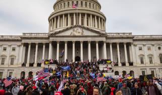 Pro-Trump protesters storm the Captiol building.