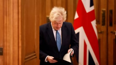 Boris Johnson attends a virtual press conference inside 10 Downing Street