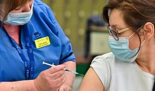 A woman receives her Covid vaccine in Edinburgh, Scotland