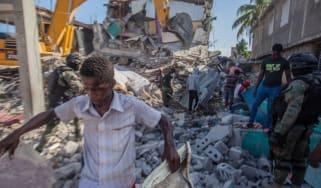 Survivors search earthquake rubble