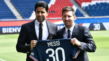 PSG president Nasser Al-Khelaifi and Lionel Messi