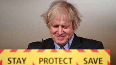 Boris Johnson smiles during a televised press conference