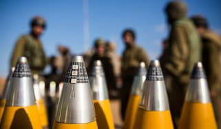 Israeli troops with artillery shells waiting to be fired into Gaza