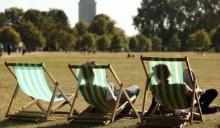 LONDON, ENGLAND - SEPTEMBER 08:Members of the public recline in deckchairs as they enjoy the afternoon sunshine in Hyde Park on September 8, 2009 in London, England. Temperatures in the capit