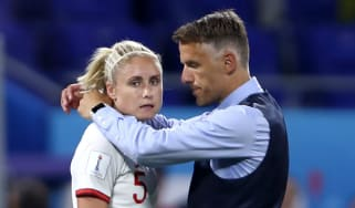 England head coach Phil Neville consoles Steph Houghton after the defeat against the United States