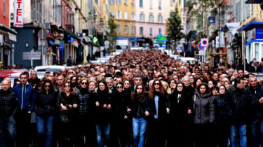 Thousands of people take part in a march on March 25, 2014 in Bastia, to pay homage to Jean Leccia, a 53-year-old government services director, killed two days before at the wheel of his car