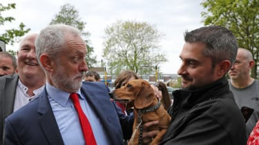 Jeremy Corbyn is startled by Cody the Dachshund during a 2017 campaign event