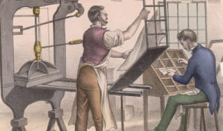 Illustration depicting a 19th century printer and typesetter in a workshop, circa 1850. The printer stands at the press while the typesetter sits selecting types for composition. (Photo by Hu