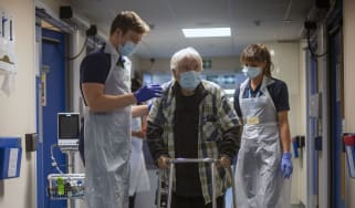 Rehab Support workers help a patient.