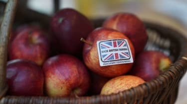 A 'Back British Farming' sticker adorns an apple during the National Farmers Union annual conference earlier this year