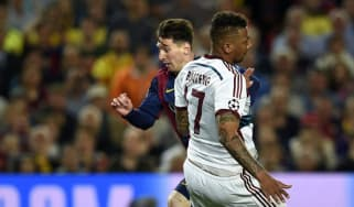 Lionel Messi speeds past Jerome Boateng