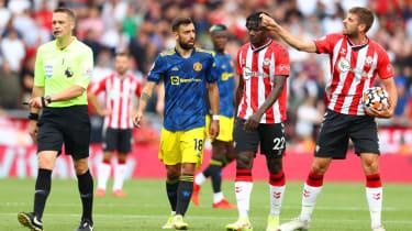 Man Utd's Bruno Fernandes confronts Southampton's Jack Stephens