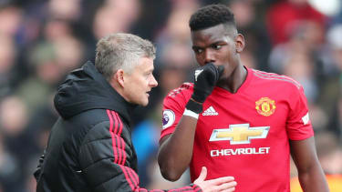 Manchester United manager Ole Gunnar Solskjaer and French midfielder Paul Pogba