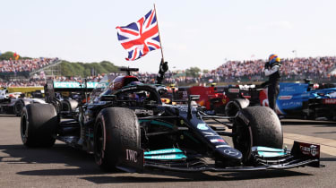 Mercedes driver Lewis Hamilton celebrates his win at the 2021 British Grand Prix