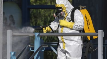 Ebola health worker wearing a full biohazard suit