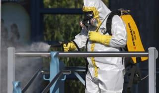 Ebola health worker wearing a full biohazard suit
