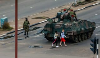 Military vehicles remain in strategic locations throughout Harare