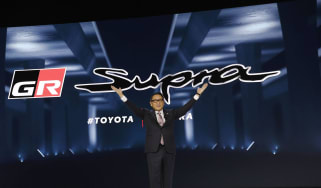 DETROIT, MI -JANUARY 14: Akio Toyoda, President of Toyota Motor Corporation, stands with The 2020 Toyota Supra rear-wheel-drive sports coupe at its reveal at the 2019 North American Internati