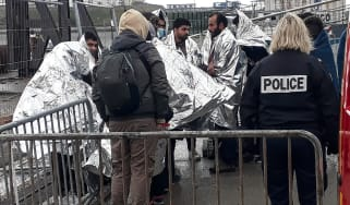 French rescue teams help a group of migrants in Calais