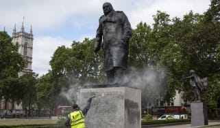 A worker cleans the Churchill statue in Parliament Square