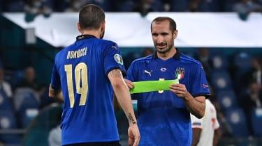 Italy captain Giorgio Chiellini passes the armband to Leonardo Bonucci