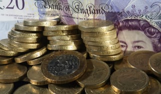 Pound coins and bank note