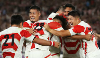 Japan celebrate their victory over Scotland at the Rugby World Cup