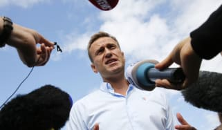 Alexei Navalny speaks with journalists during a rally