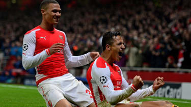 Alexis Sanchez and Kieran Gibbs of Arsenal celebrate after scoring during the match between Arsenal and Borussia Dortmund