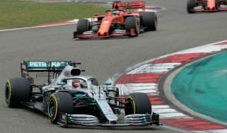 Mercedes driver Lewis Hamilton races against the Ferraris at the 2019 Chinese Grand Prix