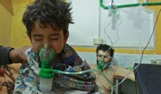 Syrian children and adults receive treatment for a suspected chemical attack