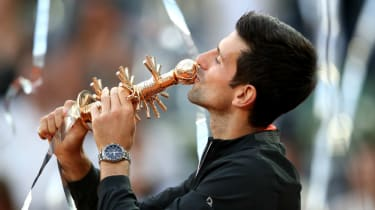 Novak Djokovic kisses the trophy after beating Stefano Tsitsipas in the Madrid Open final