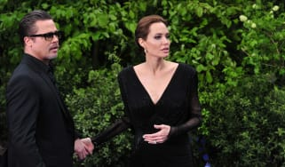 Angelina Jolie and Brad Pitt arrive for the premiere of Maleficent at Kensington Palace