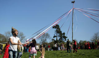 People dancing around the May pole