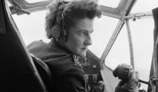 Pilot Monique Rendall in the cockpit of an aircraft in 1955